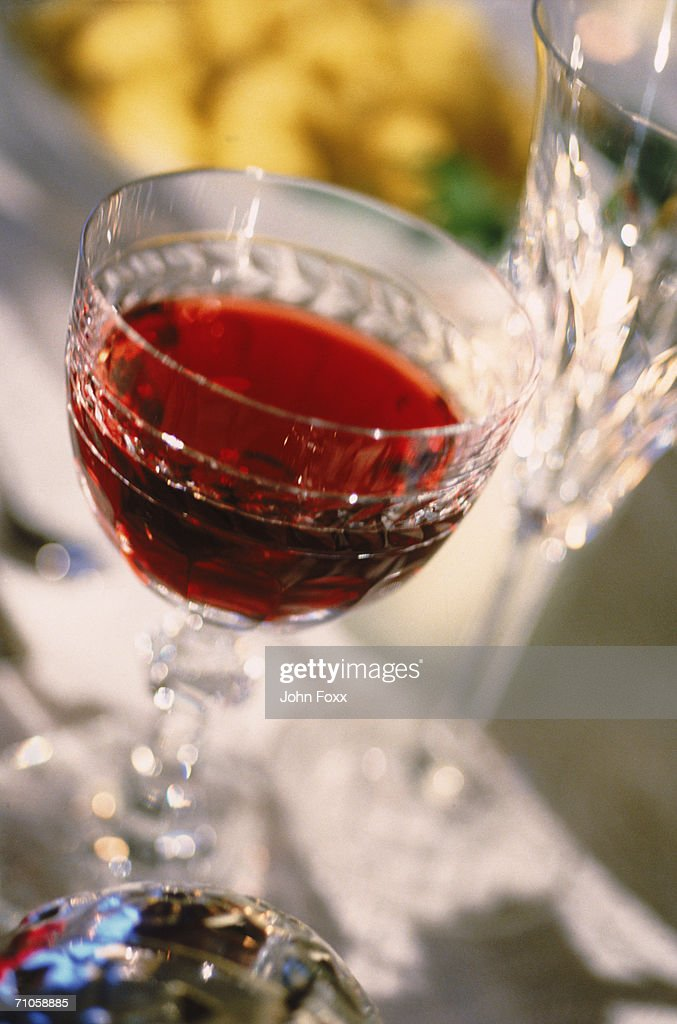 Red wine glass on table