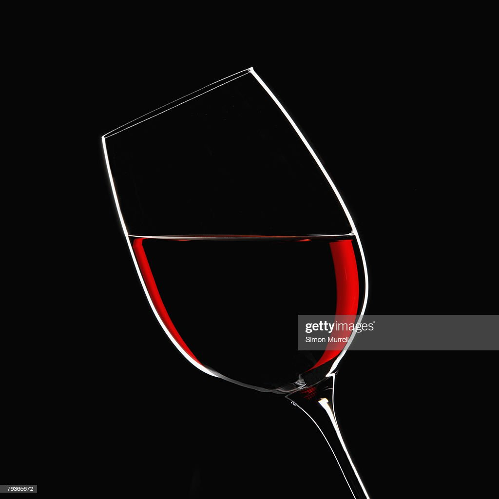 Red wine in glass indoors : Stock Photo