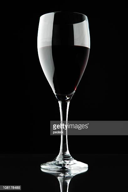 Red Wine in Glass on Black Background