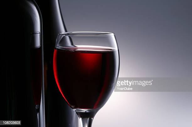 red wine in wineglass with bottle