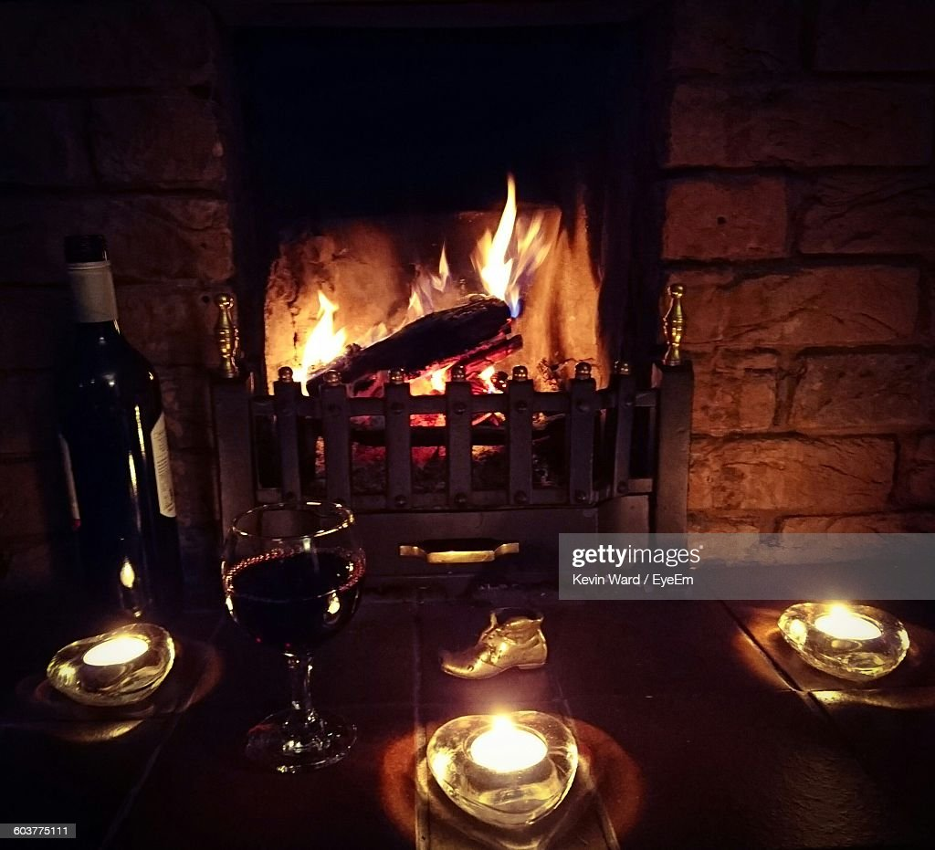 wine and fireplace stock photo getty images