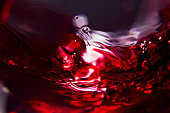 Red wine on a black background , abstract splashing.