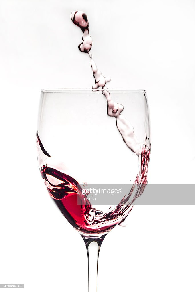 red wine pouring in glass