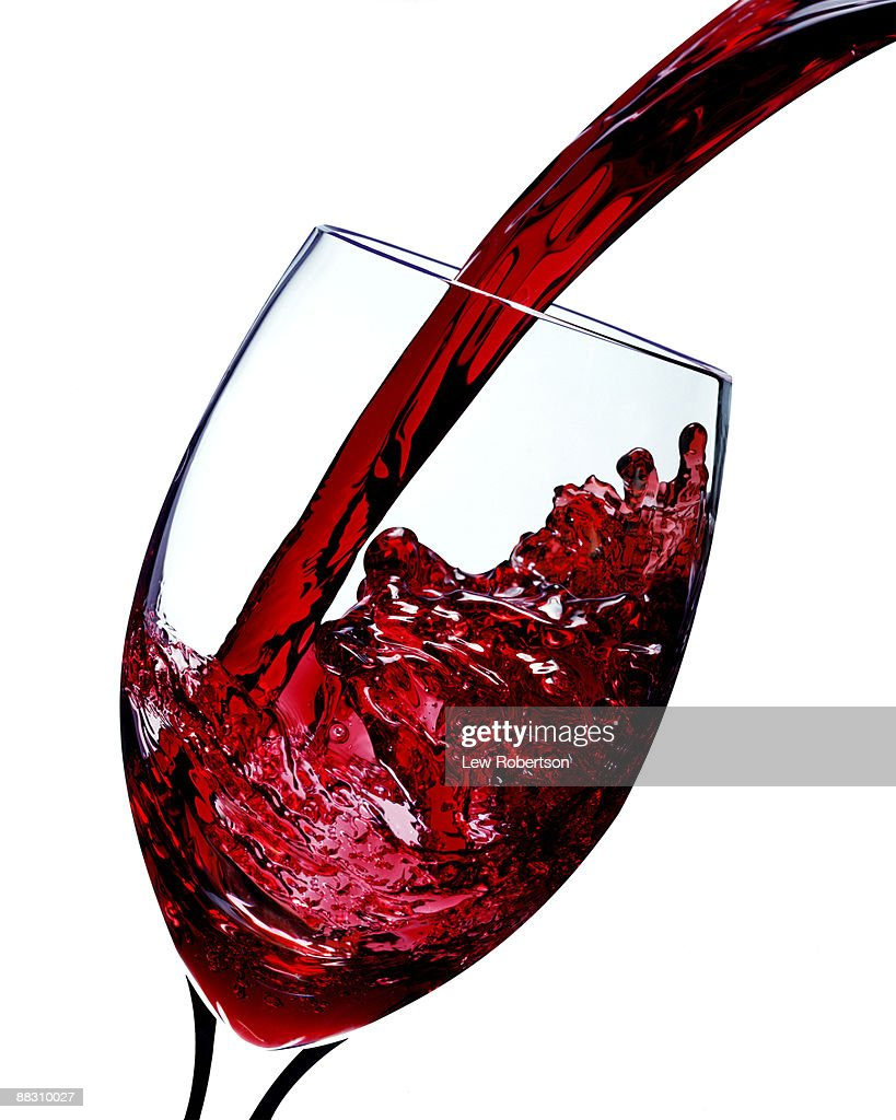Red wine pouring into glass : Stock Photo