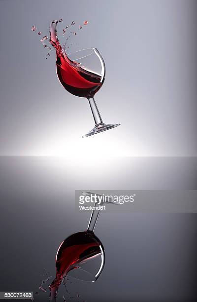 Red wine shaking in glass