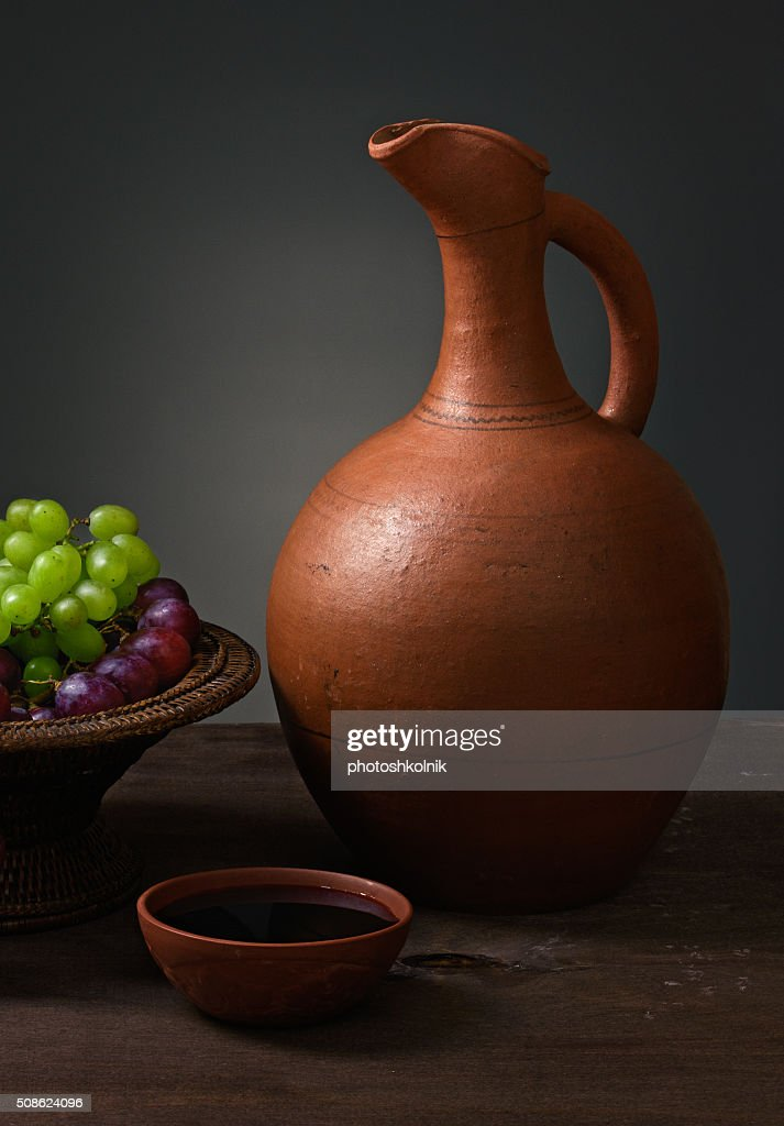 red wine with grapes and a pitcher : Stock Photo