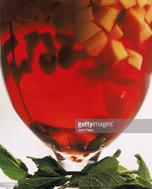 Red wine with mint leaves, close-up