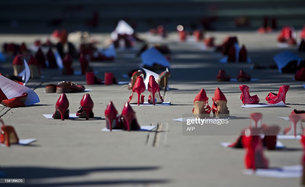 Red woman shoes symbolizing missing women remain in front of the State Attorney Office during a demo in Ciudad Juarez Mexico on December 10 2012...
