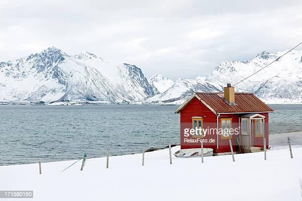 Red wooden home (rorbu) in winter on Lofoten Islands, Norway