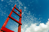 Red Staircase Rests Against Blue Sky. Development Motivation Business Career Growth Concept