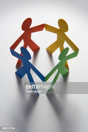 red, yellow, green & blue cut out figures forming  : Stock Photo