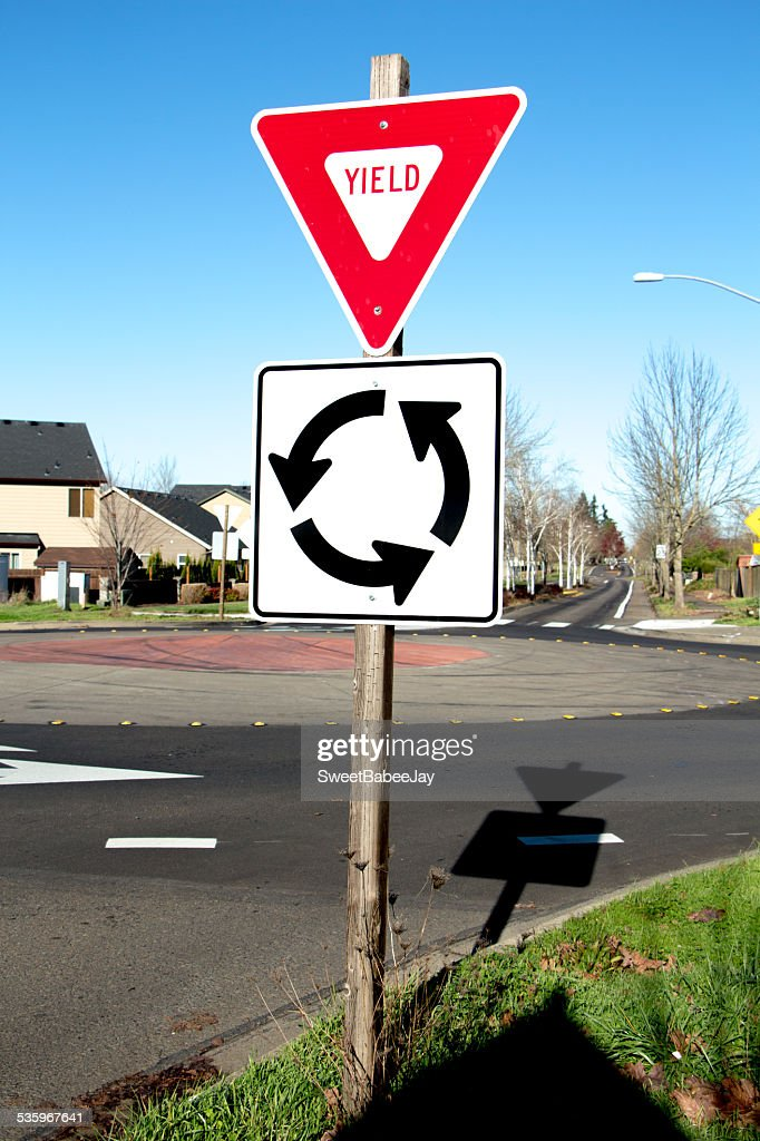 Red Yield & Whtie Roundabout Sign : Stock Photo