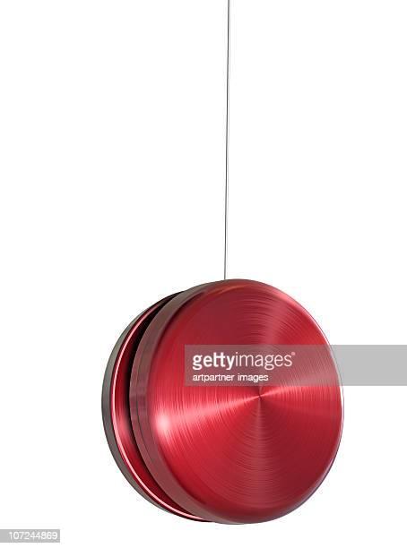 Red Yo-Yo on White Background