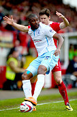 Reda Johson of Coventry controls the ball under pressure from Josh Simpson of Crawley during the Sky Bet League One match between Crawley Town and...