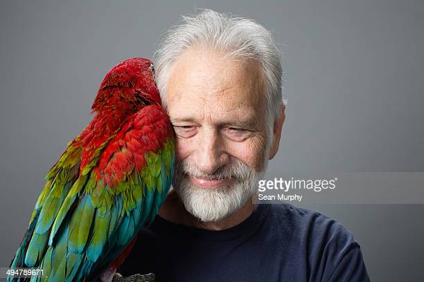 Red-and-green Macaw Hugging Man