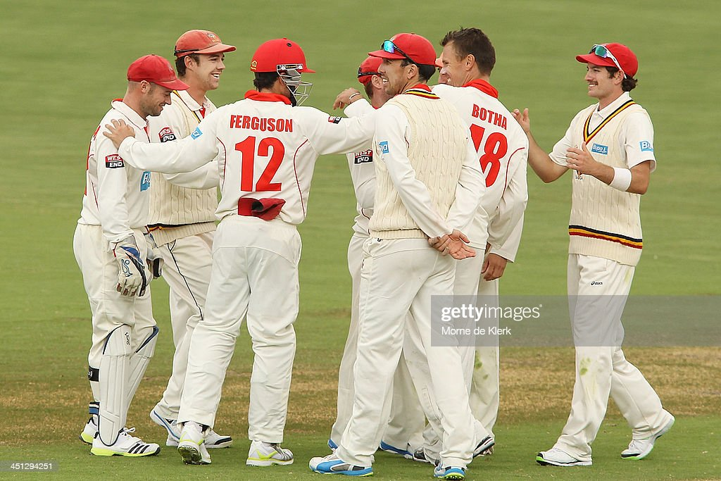 Redbacks players celebrate a wicket during day one of the Sheffield Shield match between the South Australia Redbacks and the Tasmania Tigers at Adelaide Oval on November 22, 2013 in Adelaide, Australia.