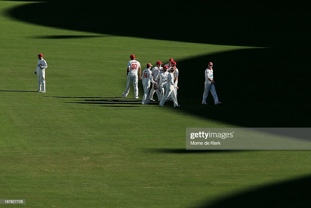 Redbacks players leave the field after day one of the Sheffield Shield match between the Redbacks and the Warriors at Adelaide Oval on November 13, 2013 in Adelaide, Australia.