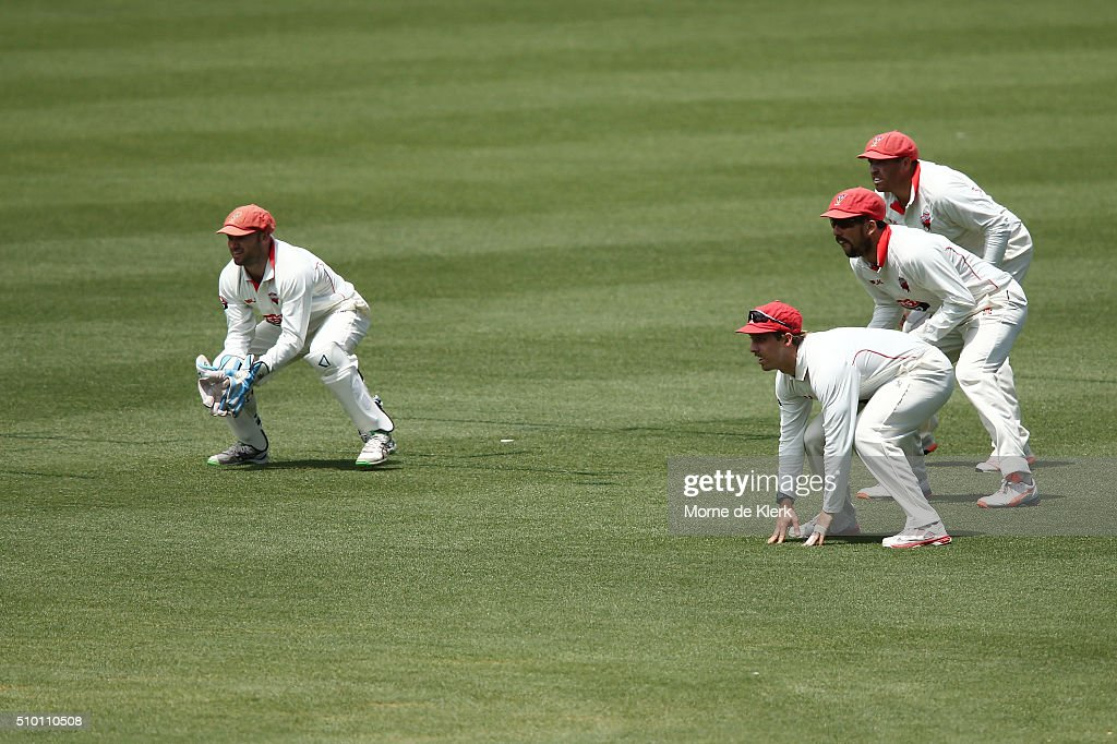 Redbacks players stand in the field during day one of the Sheffield Shield match between South Australia and Victoria at Adelaide Oval on February 14, 2016 in Adelaide, Australia.