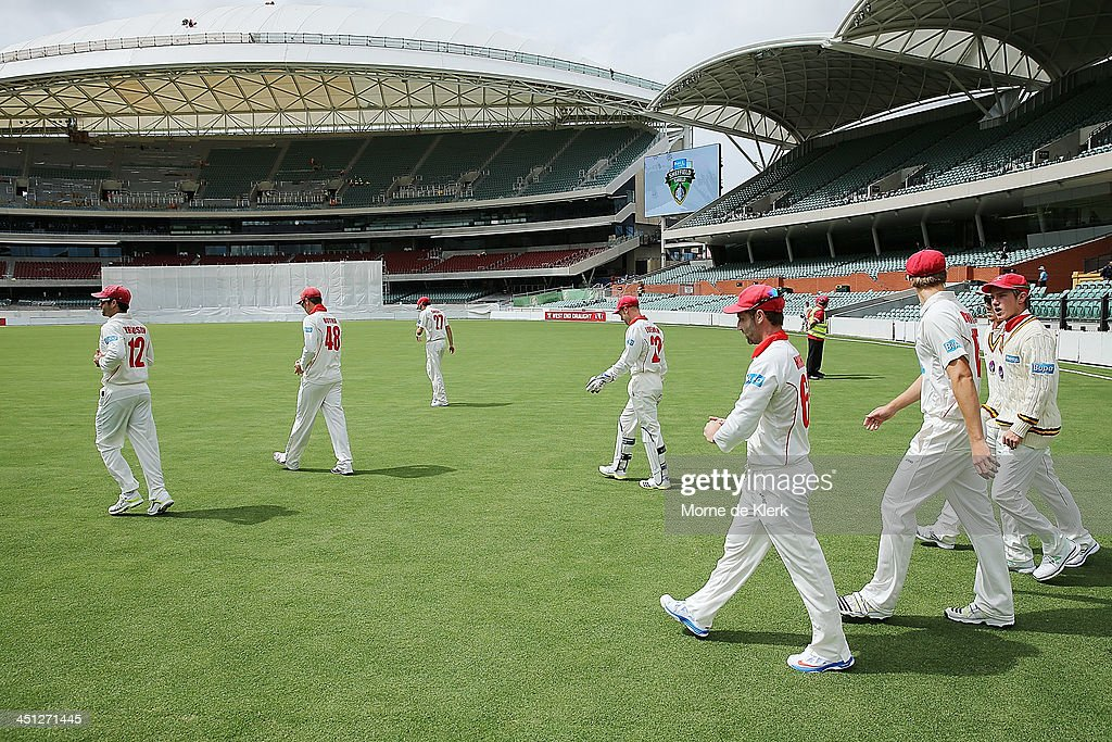 Redbacks players take to the field before during day one of the Sheffield Shield match between the South Australia Redbacks and the Tasmania Tigers at Adelaide Oval on November 22, 2013 in Adelaide, Australia.