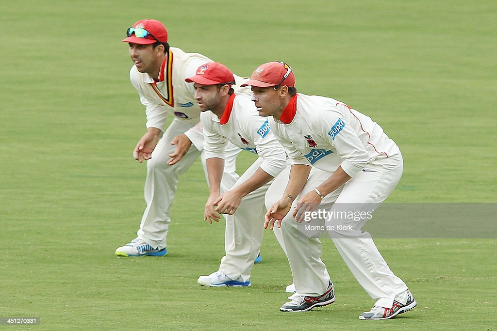 Redbacks players (L-R) Tom Cooper, <a gi-track='captionPersonalityLinkClicked' href=/galleries/search?phrase=Phillip+Hughes+-+Cricketer&family=editorial&specificpeople=757530 ng-click='$event.stopPropagation()'>Phillip Hughes</a> and Johan Botha fields in the slips during day one of the Sheffield Shield match between the South Australia Redbacks and the Tasmania Tigers at Adelaide Oval on November 22, 2013 in Adelaide, Australia.