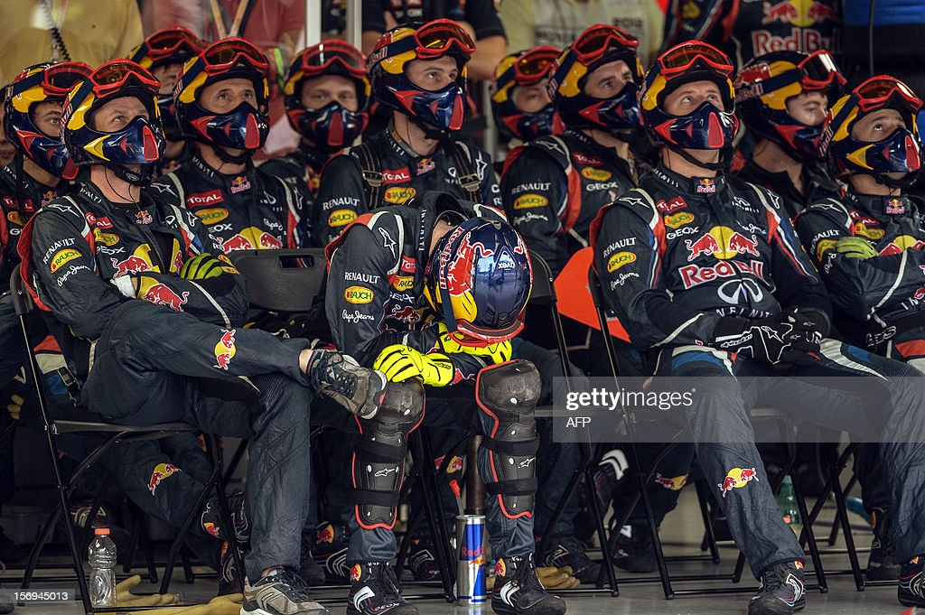 RedBull team follows the race at the pits of Interlagos racetrack , during the Brazil's F-1 GP on November 25, 2012 in Sao Paulo, Brazil. AFP PHOTO