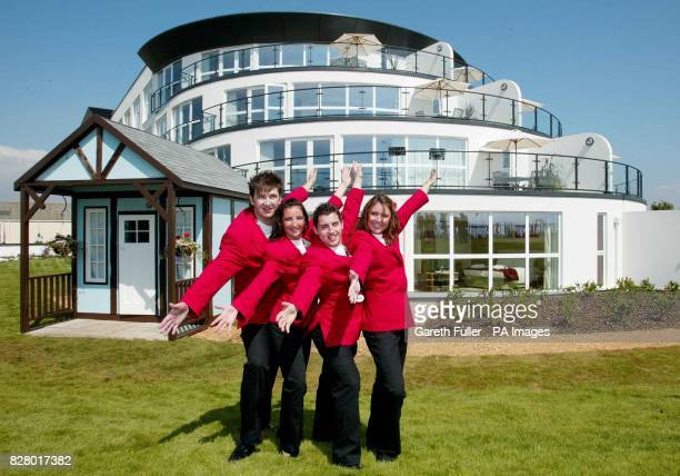 Redcoats Oli Catt Emma Saint Andy Burton and Laura Miller pose for photographers in front of an original 1936 chalet and thier new hotel as Butlins...