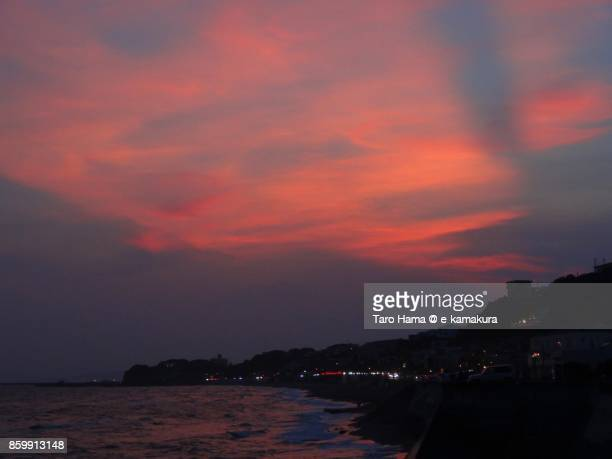 Red-colored sunset clouds on Mt. Fuji and the beach in Kamakura city in Kanagawa prefecture in Japan