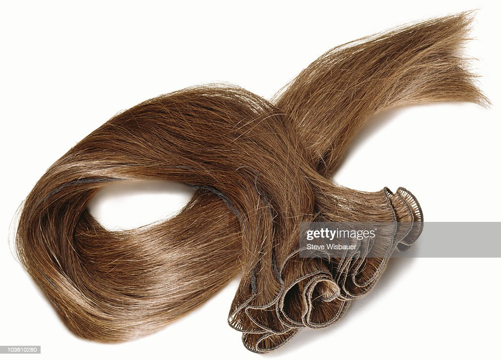 A reddish brown hair extension : Stock Photo