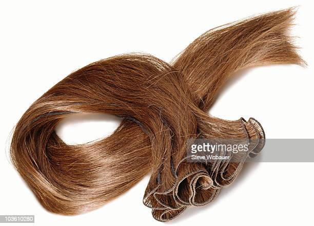 A reddish brown hair extension