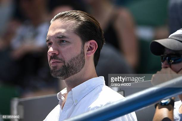 Reddit founder Alexis Ohanian and fiance of Serena Williams of the US watches her women's singles match against Switzerland's Belinda Bencic on day...