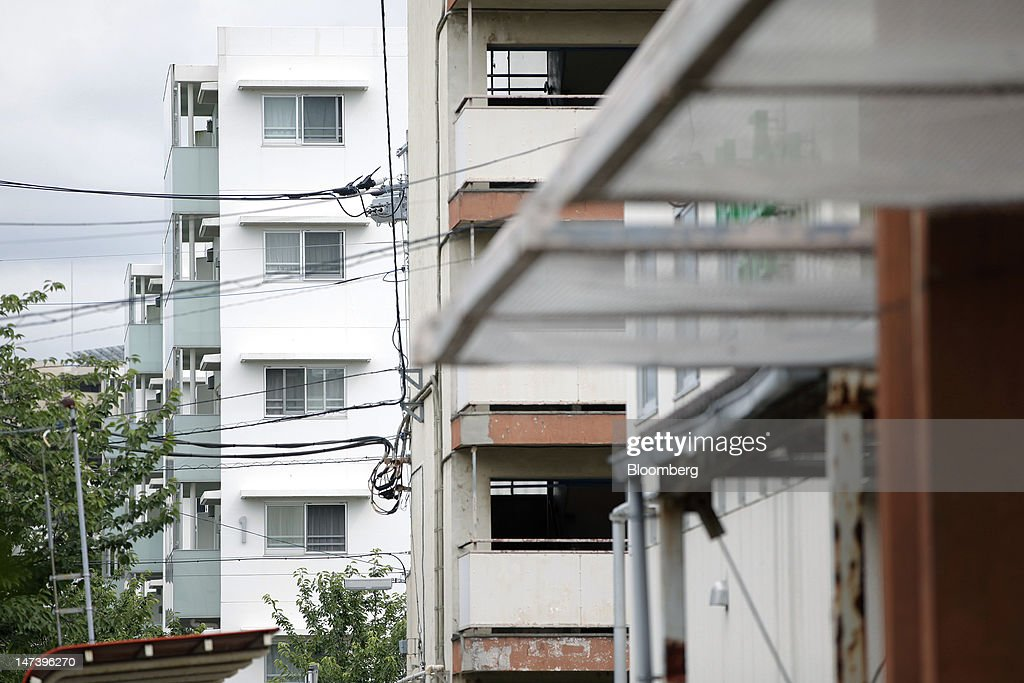 A redesigned local housing complex, left, stands next to an existing local housing complex in Kashiwa City, Chiba Prefecture, Japan, on Thursday, June 28, 2012. Japan ages faster than any other developed society, with 23 percent of the population 65 or older, according to government figures. Photographer: Kiyoshi Ota/Bloomberg via Getty Images