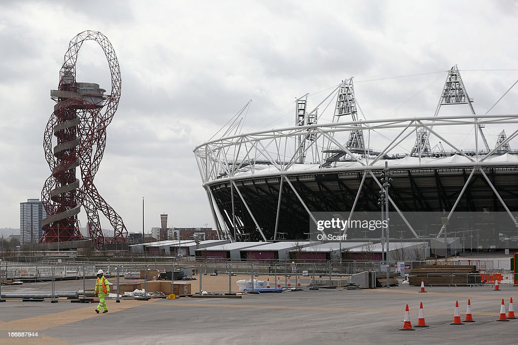Redevelopment work takes place around the ArcelorMittal Orbit on the site of London 2012 Olympic Games prior to the opening of a portion of the park to the general public on April 16, 2013 in London, England. In 100 days the first section of the developed site of the 2012 Olympic Games, which will be known as Queen Elizabeth Olympic Park, will welcome visitors. The park's 292 million GBP conversion includes the removal of temporary venues, the refitting of stadia for public use, the removal of Olympic Games sponsor's retail units and extensive landscaping. The re-opening of the northern portion of the park will take place on July 27, 2013, on first anniversary of the London 2012 Olympics, for a festival celebrating the culture of East London. The park will be fully open to the public in spring 2014.