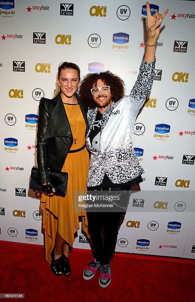 <a gi-track='captionPersonalityLinkClicked' href=/galleries/search?phrase=Redfoo&family=editorial&specificpeople=5857552 ng-click='$event.stopPropagation()'>Redfoo</a> and girlfriend <a gi-track='captionPersonalityLinkClicked' href=/galleries/search?phrase=Victoria+Azarenka&family=editorial&specificpeople=604872 ng-click='$event.stopPropagation()'>Victoria Azarenka</a> step on the red carpet at OK! Magazine Pre-Oscar Party at The Emerson Theatre on February 22, 2013 in Hollywood, California.