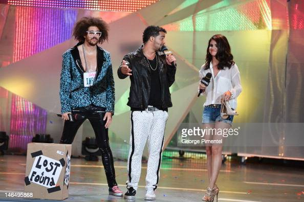 Redfoo and SkyBlu of LMFAO and Selena Gomez during the 2012 MuchMusic Video Awards at MuchMusic HQ on June 17 2012 in Toronto Canada