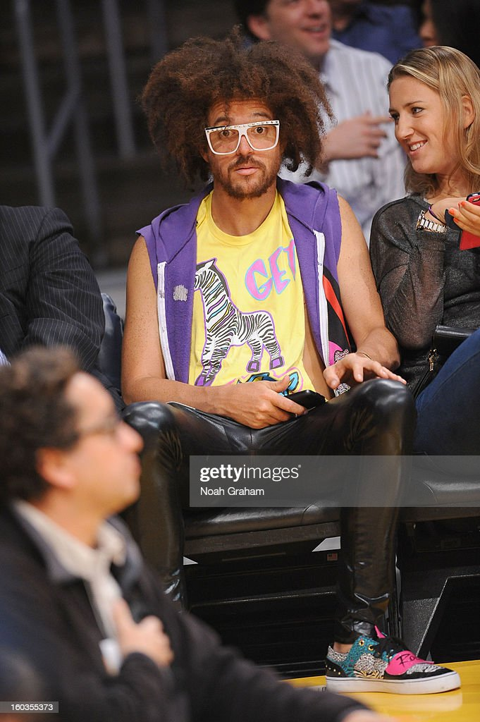 RedFoo of LMFAO and Australian Open women's champion Victoria Azarenka attend a game between the New Orleans Hornets and the Los Angeles Lakers at Staples Center on January 29, 2013 in Los Angeles, California.