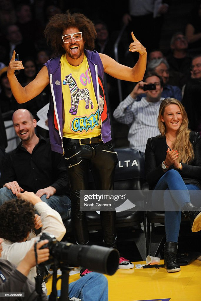 Redfoo of the group LMFAO and Australian Open women's champion Victoria Azarenka attends a Los Angeles Lakers game against the New Orleans Hornets at Staples Center on January 29, 2013 in Los Angeles, California.