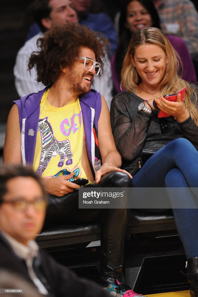 Redfoo of the group LMFAO and Australian Open women's champion Victoria Azarenka attend a Los Angeles Lakers game against the New Orleans Hornets at Staples Center on January 29, 2013 in Los Angeles, California.