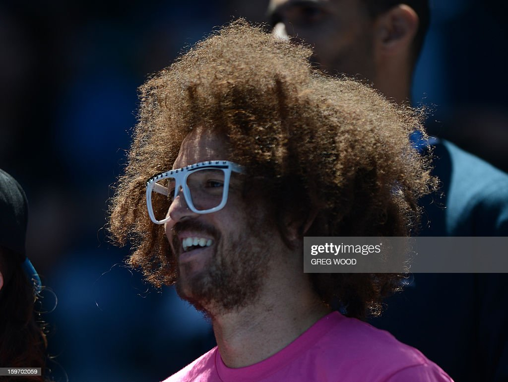 'Redfoo' the musician looks on as Belarus's Victoria Azarenka wins her women's singles match against Jamie Hampton of the US on the sixth day of the Australian Open tennis tournament in Melbourne on January 19, 2013.