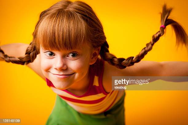Red-Haired Girl with Upward Braids and Goofy Grin