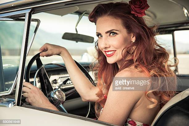 Redhead 50s Pinup Girl Driving Classic Car