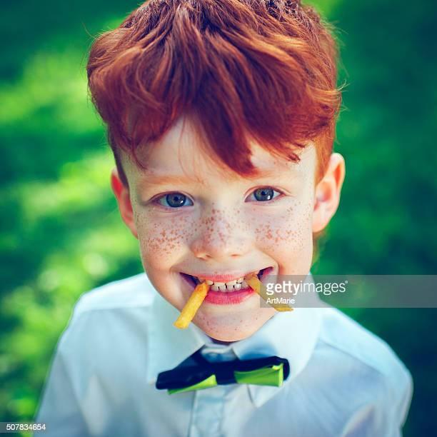 Redhead boy outdoors