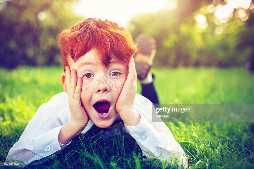Redhead boy outdoors : Stock Photo