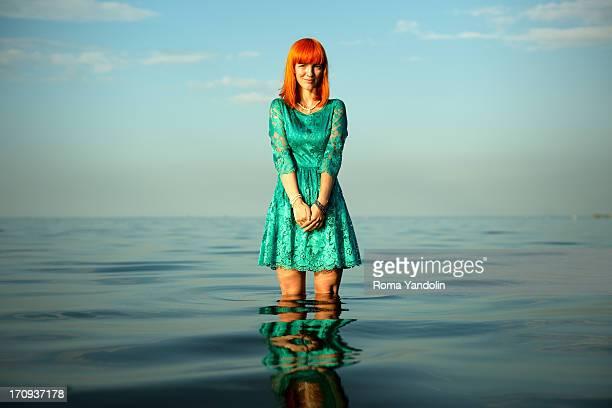 Redhead girl at the sea