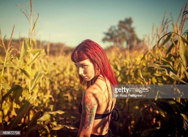 Redhead in cornfield