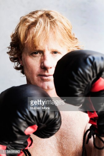 Redhead with boxing gloves : Stock Photo