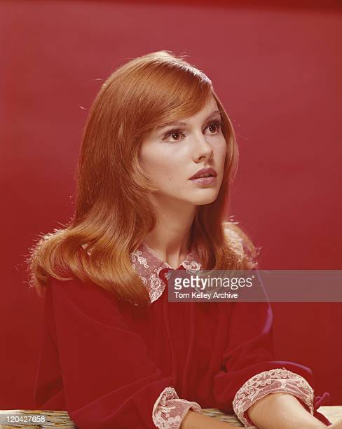 Redhead woman against red background