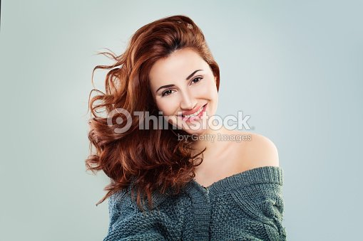 Redhead Woman Fashion Model Smiling. Pretty Girl on Grey Background : Foto stock
