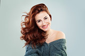 Redhead Woman Fashion Model Smiling. Pretty Girl on Grey Background