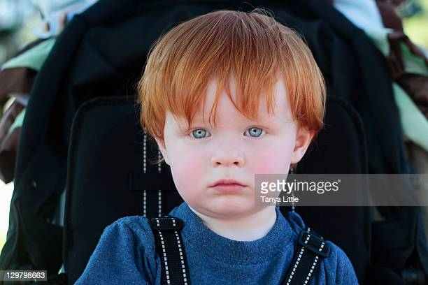 Redheaded boy in stroller