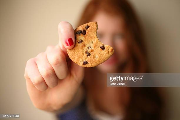 Redheaded Girl Holding a Chocolate Chip Cookie